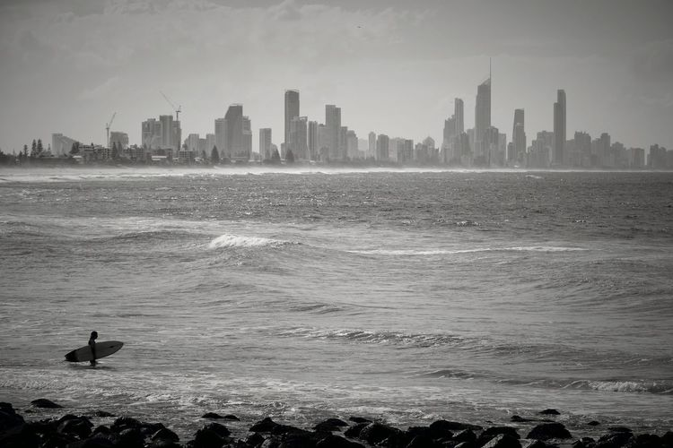 Australia Gold Coast Surfer Surfers Paradise City Lifestyles Surfing Urban Skyline Water Wave Scenery Ocean Sports EyeEmNewHere Cool_capture_ Stories From The City