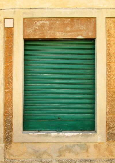 Metal Shutter Shutter Window Green Yellow Brown Orange Textures And Surfaces ArchiTexture Architectural Detail Background Concrete Weathered Wall Scratched And Cracked Wall Old Windows