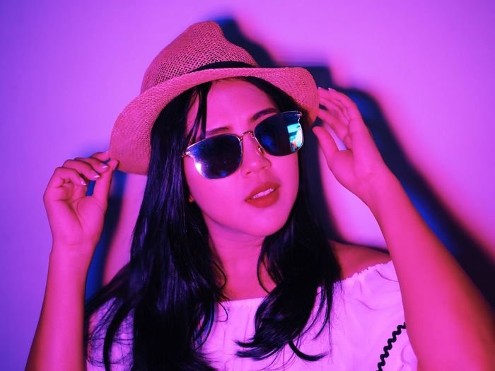 Fashion Front View One Person Pink Color Glasses Portrait Long Hair Sunglasses Hairstyle Indoors  Women Young Adult Hair Headshot Beautiful Woman Young Women Leisure Activity Lifestyles Looking At Camera Purple