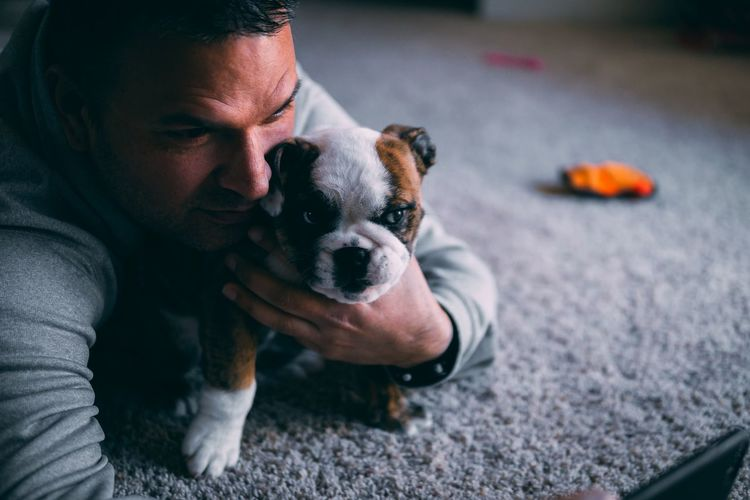 Close-up of man taking selfie with puppy