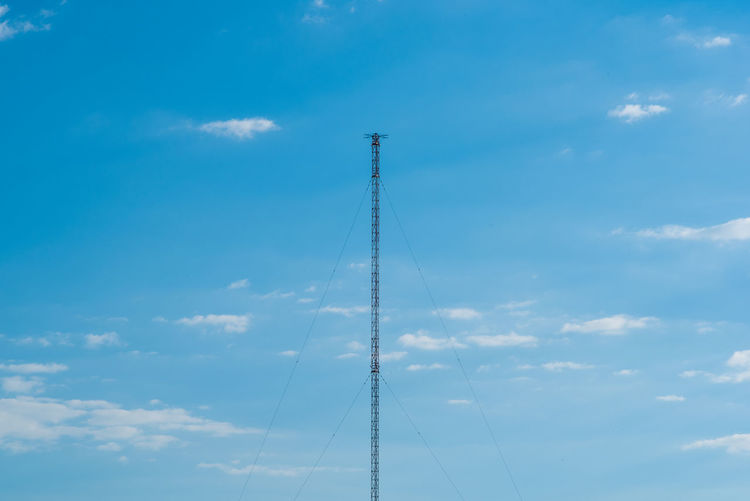Telecommunication tower against blue sky Antenna Blue Broadcasting Tower Cloud - Sky Day High Low Angle View No People Outdoors Radio Radio Tower Sky Telecommunications Equipment TelecommunicationTower Tower
