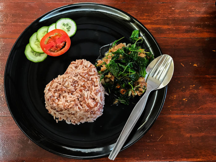 Tuna Pad Kra Prow or Tuna with basil over Riceberry is a classic Thailand traditional food. Food And Drink Kra Prow Pad Kra Prow Thai Bowl Close-up Day Food Food And Drink Freshness Healthy Eating High Angle View Indoors  No People Plate Ready-to-eat Table Traditional Traditional Food Tuna Vegetable