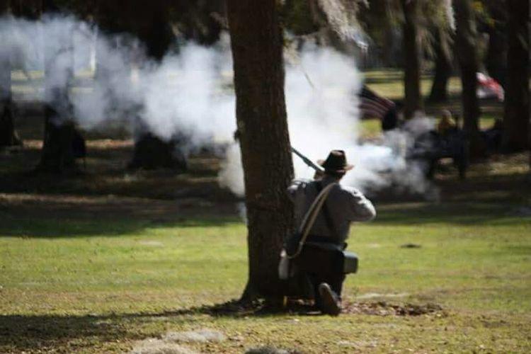 Soldier firing. Civil War reenactment Soldier Firing The Rifle. Civil War Re-enactments History Smokey Battlefield