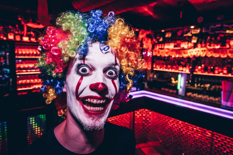 IT Bar Clown Creepy Focus On Foreground Halloween Lifestyles Looking At Camera Multi Colored Night One Person People Portrait Smiling