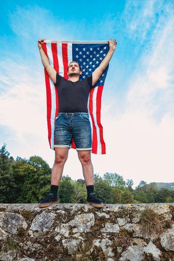 Full length portrait of man standing on rock