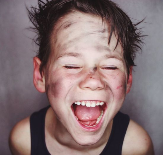 Close-up of boy screaming