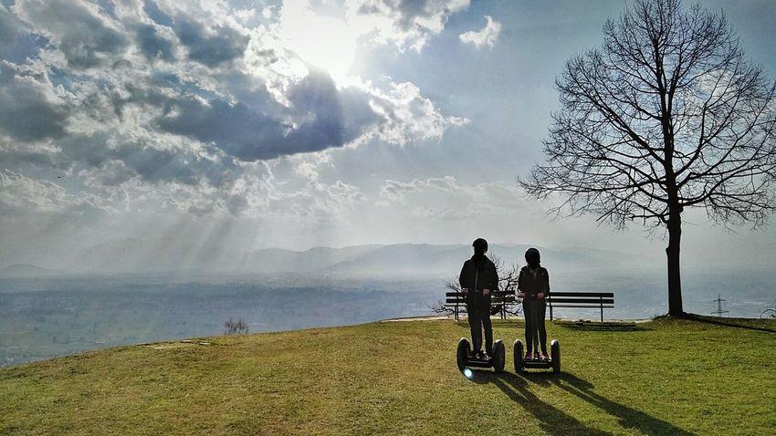 Two People on Segway Personal Transporter, Model: Se Pt  I2 I2 Se Pt, In Front Of Dramatic Sky in Bildstein, Vorarlberg  Laendle, Austria