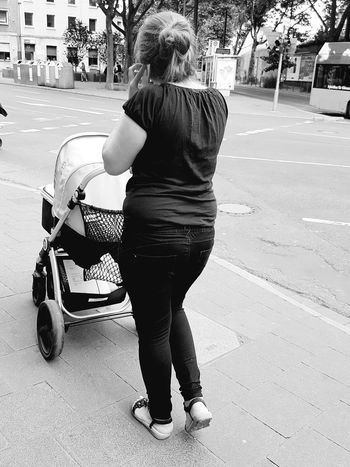 Portrait From Behind Smartphone Syndrome Portrait Of A Woman Portrait Photography Black And White Portrait Black And White Collection  Black And White Photography Walking Stroller Baby Stroller Streetphoto_bw Street Photography Street Life City Life City Street My City Mobile Phone GalaxyS7Edge People Of EyeEm Streetphoto Eyeem Collection Summertime People Walking  Monochrome Photography
