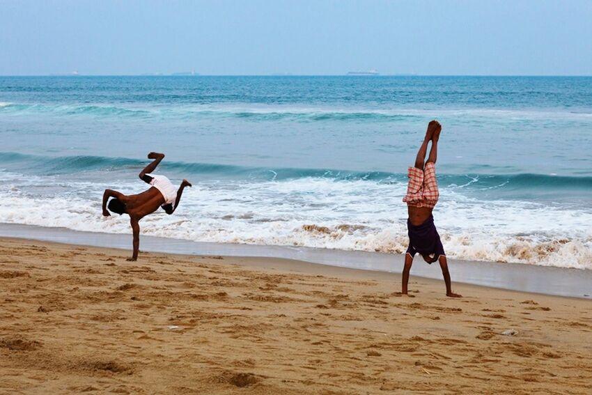 Sea Ocean Beach Acrobatic India Marji Lang Photography Men Fun Acrobat Playing On The Beach Tamilnadu Chennai Marina Beach  Alternative Fitness Sea Fun Two Young Adult Beach Life People Indian Acrobatics  Fitness Upside Down