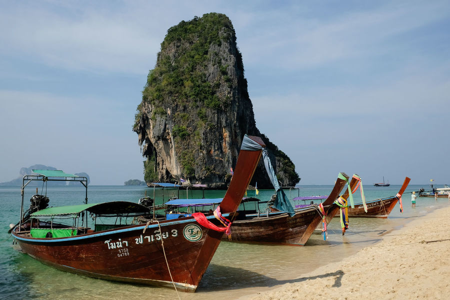 Long tail boats on Railay Beach in Thailand Beach Long Tail Boat Mode Of Transport Nautical Vessel Outdoors Railay Beach Sea Sky Thailand Transportation Travel Travel Destinations Water