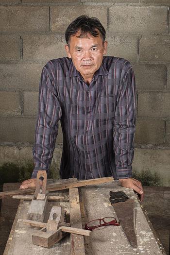 Carpenter Working In Carpentry Workshop