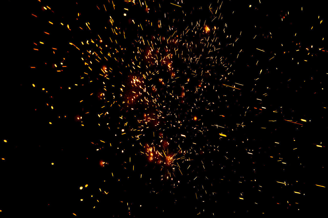 firework display, exploding, sparks, firework - man made object, night, motion, celebration, long exposure, glowing, arts culture and entertainment, blurred motion, burning, fire, event, low angle view, firework, outdoors, flame, illuminated, no people, multi colored, sky