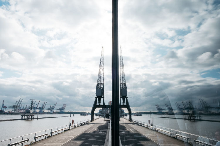 Architecture Bridge - Man Made Structure Building Exterior Built Structure City Cloud - Sky Connection Day Harbor Mast Mode Of Transport Modern Nautical Vessel No People Outdoors River Sky Suspension Bridge Transportation Water