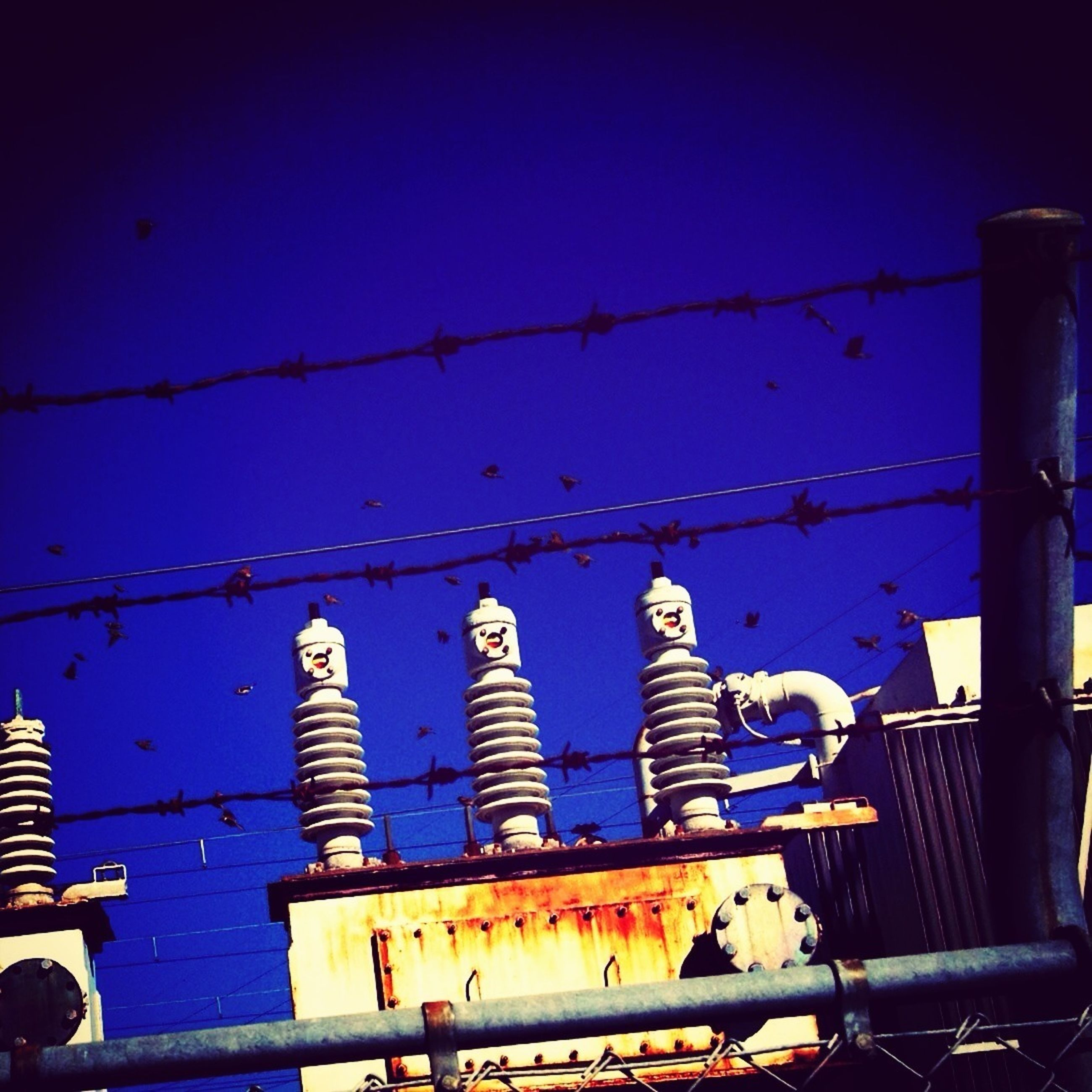 metal, blue, low angle view, sky, rusty, metallic, industry, no people, built structure, abandoned, outdoors, factory, in a row, old, day, architecture, equipment, side by side, building exterior, run-down