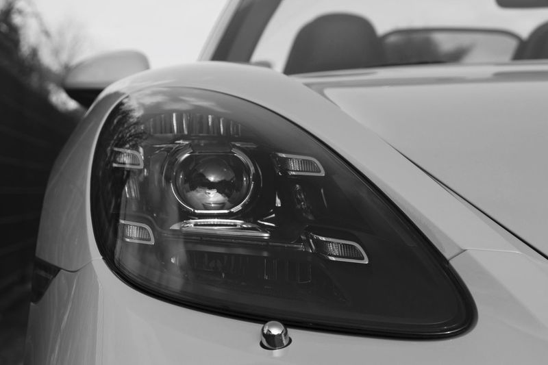 Porsche 817 Boxter Supercar Blackandwhite Carphotography Porsche Car Land Vehicle Motor Vehicle Mode Of Transportation Close-up Transportation Headlight Focus On Foreground No People Retro Styled Technology Indoors  Day Car Interior Luxury Modern Wealth Reflection Chrome