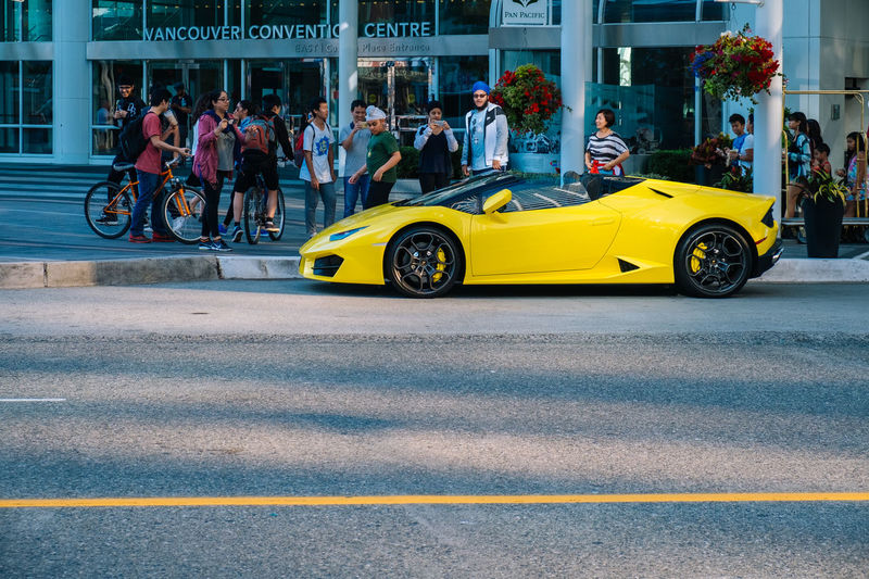 LamborghiniLovers Yellow Flower Adult Adults Only Architecture Building Exterior Built Structure Car City Crowd Day Lamborghini Lamborgini  Land Vehicle Large Group Of People Men Mode Of Transport Outdoors People Real People Street Transportation Yellow