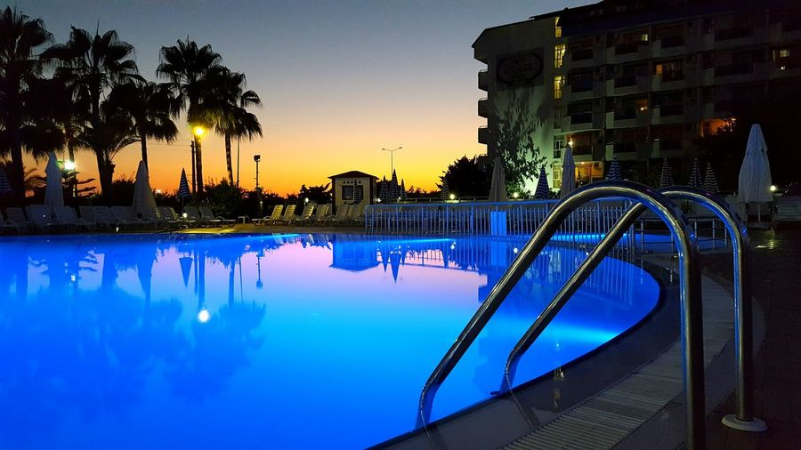 Swimming Pool By Hotel During Sunset