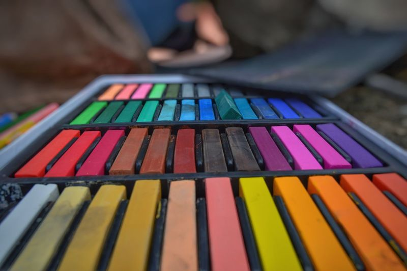 Close-up of colorful crayons on table