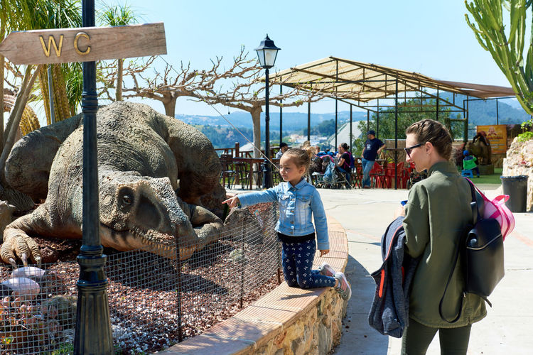 Algar, Spain - April 8, 2017: People in the Dino Park of Algar. It is a unique entertainment and educational park. Spain älgar Alicante, Spain Dino DinoPark Dinosaur Hunter Jurassic Park Reptile SPAIN Amusement Park Animal Themes Child Childhood Day Dino Park Editorial  Entertainment Park Jurassic Period Kid Outdoors Paleontology People Real People Realistic Sunny Day