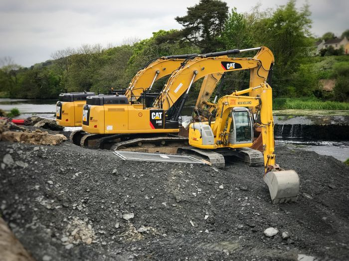 Construction Site Construction Machinery Earth Mover Sky Construction Vehicle Transportation Road Outdoors Day Landscape No People Tree Bandon County Cork Ireland Flood Relief Excavators Excavator Backhoe Heavy Machinery Caterpillar