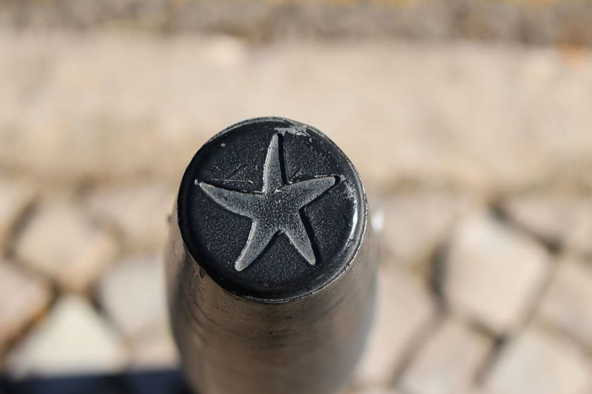 Cobblestone Streets Metal Post Minimalist Perspective Post Abstract Backgrounds Close-up Cobblestone Day Details Different Perspective Different Points Of View Focus On Foreground Metal Metallic Minimal Minimalism No People Outdoors Simplicity Star Star Shape Street Street Photography