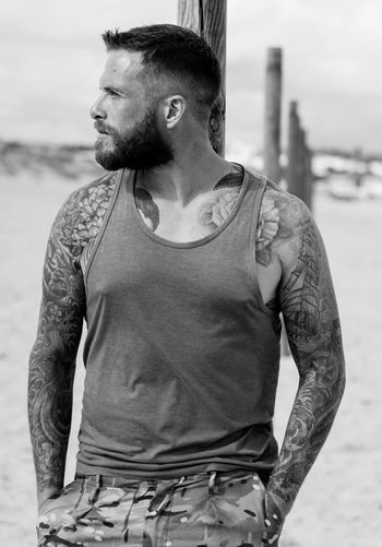 bearded tattooed man modeling Beach Photography EyeEmNewHere Tattooed Beard Bearded Black And White Blackandwhite Blackandwhite Photography Day Focus On Foreground Handsome Male Model One Person Outdoors People People Photography Real People Standing Tattoo Tattoos Young Adult Young Men Black And White Friday Inner Power