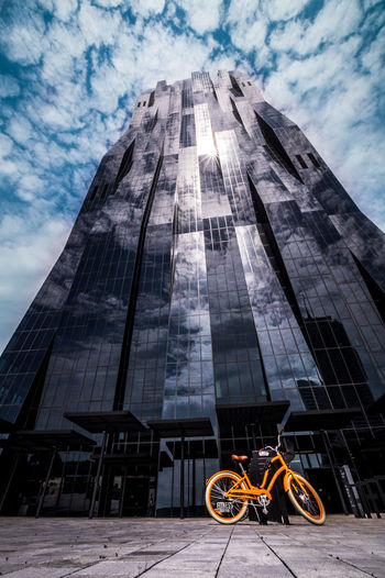 Story of the orange bike Architecture Bicycle Bike Building Building Exterior Buildings & Sky Built Structure City City Bike City Life Cloud - Sky Day DC Tower Donau City Dramatic Sky Low Angle View No People Outdoors Reflection Reflections In The Glass Windows Sky Sun Vienna Wide Angle View EyeEmNewHere