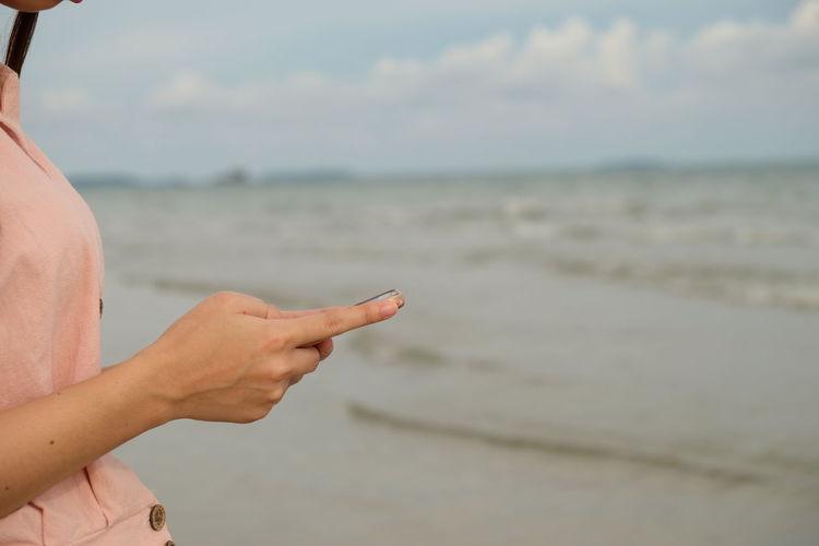 Close-up of hand on beach