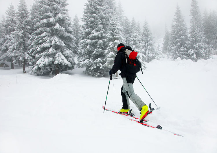 Man skiing on snow covered field