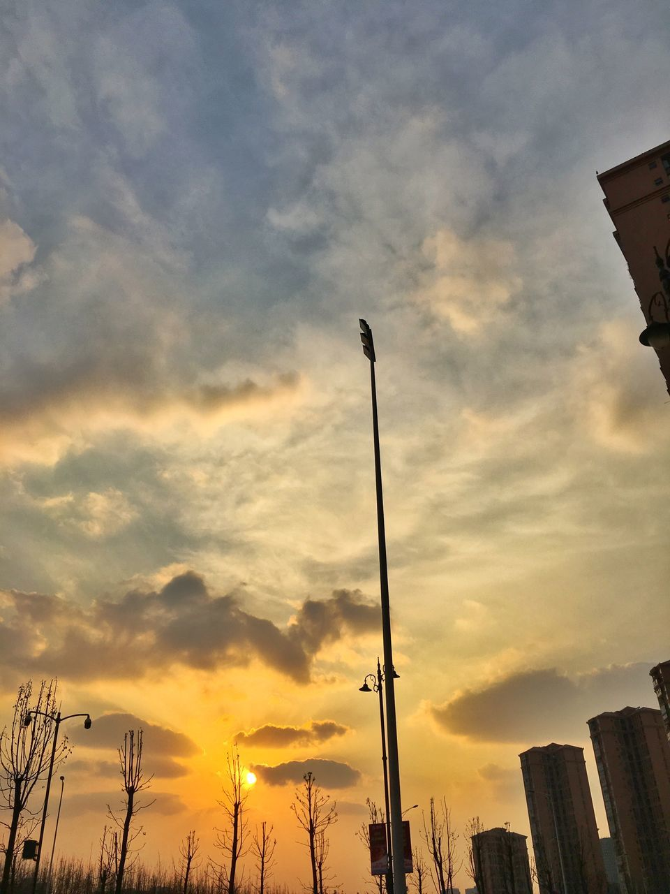 Low Angle View Of Silhouette Pole Against Cloudy Sky During Sunset
