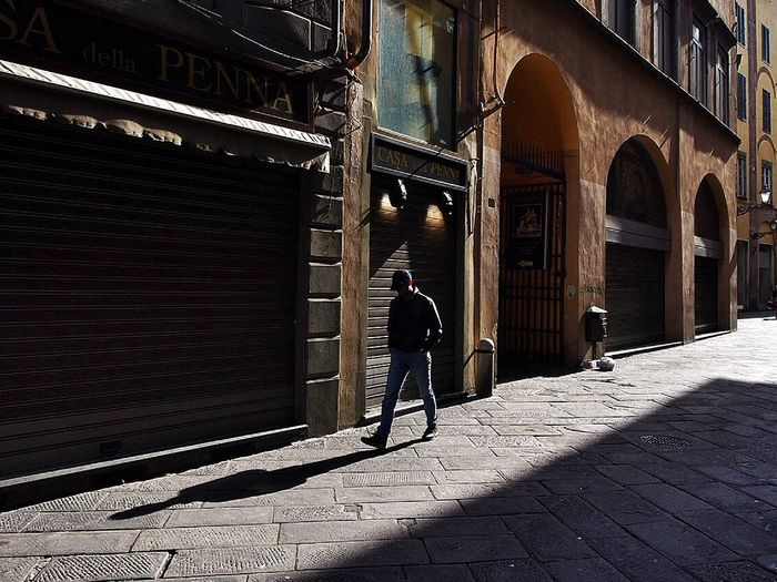 Walking in the morning in the city of Lucca , Italy Lucca Morning Sunrise Street City Urban Shadows Lonely Retro Walking
