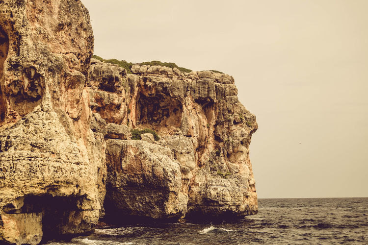 Beauty In Nature Clear Sky Cliff Day Eroded Formation Geology Horizon Over Water Nature No People Outdoors Rock Rock - Object Rock Formation Scenics - Nature Sea Sky Solid Stack Rock Tranquil Scene Tranquility Water