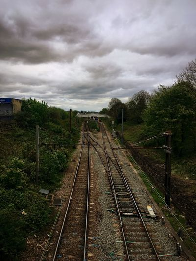 Railroad Track Rail Transportation Cloud - Sky Transportation Sky No People Public Transportation Train - Vehicle Day Outdoors Landscape Tree Built Structure Railway Nature Wood Green Resist EyeEm Diversity The Secret Spaces The Secret Spaces Long Goodbye EyeEmNewHere