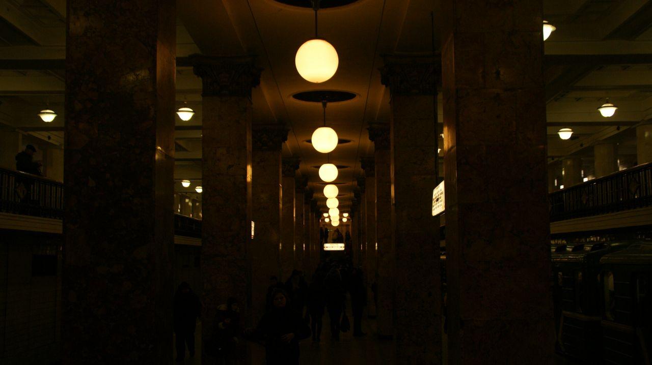 ILLUMINATED LIGHT BULBS HANGING FROM CORRIDOR