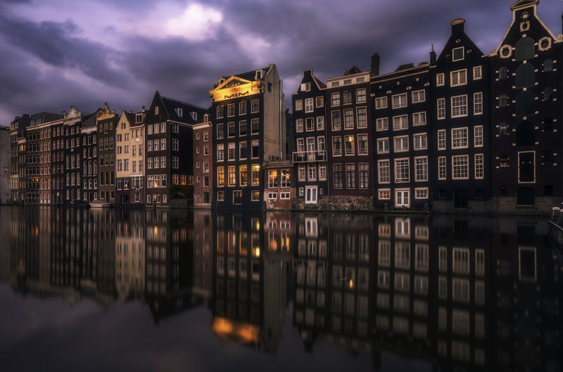When you enter the amazing city of Amsterdam via the Grand Central Station, this is one of the first views you get presented with :-) Amsterdam Reflection Remo SCarfo Architecture Building Exterior Built Structure City Cloud - Sky Dutch Holland Illuminated Night No People Outdoors Reflection Reflections In The Water River Sky Water Waterfront Wunter