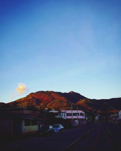 Bom dia! #BomDia #GoodDay #BuenDia #BuonGiorno #BonneJournne #GutenTag #GoodMorning #BonDia #DdiwrnodDa #BonanTagon #BonJou #Sunshine #Sunrise #Sun #Clouds Monte Hill Good MestreAlvaro Clear Sky Blue Car Sky Architecture