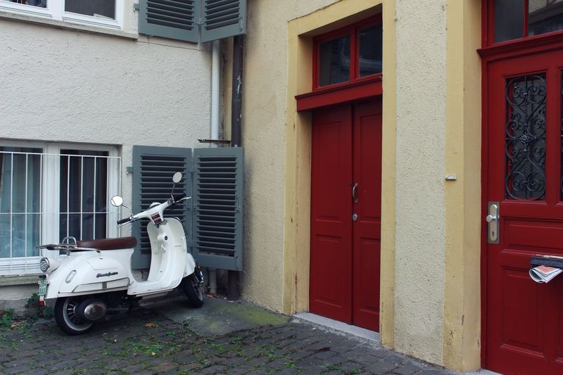 - the Vespa and the doors - Building Exterior Window Architecture Built Structure Outdoors Day No People Streetphotographer Streetphotography Mode Of Transport Transportation Land Vehicle Moped Vespa Red Color Door City Life Urban Landscape Urban Urbanity Embrace Urban Life Urban Lifestyle in Tübingen Adapted To The City Lieblingsteil The Street Photographer - 2017 EyeEm Awards