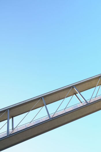 Blue Clear Sky Copy Space Abstract Sparse Landmark Simplicity Architecture Backgrounds Building Exterior Famous Place Low Angle View Connection Girder Sunlight Bridge Bridge - Man Made Structure No People Modern Modern Architecture 17.62°