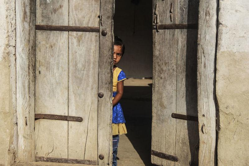 Behind the door! Behind The Door Day Door Full Length Girl One Person Outdoors People Real People Standing Street Photo The Portraitist - 2017 EyeEm Awards Wood - Material