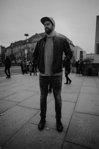 Full length portrait of young man standing in city