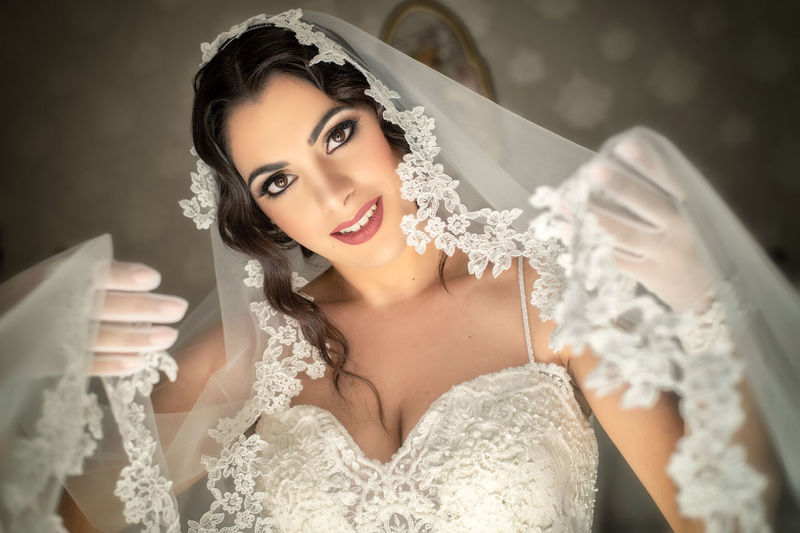 Adult Beautiful Woman Beauty Celebration Clothing Event Fashion Front View Hairstyle Happiness Indoors  Looking At Camera Newlywed One Person Portrait Real People Smiling Women Young Adult Young Women