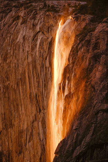"California Gold. Given certain weather conditions, at this time of the year, the sunset illuminates Horsetail Fall creating this natural phenomenon known as ""Firefall."" The experience lasts just a few minutes and it's one of nature's marvels that must be seen in person. (There wasn't enough rain to produce the firefall in 2018. This is a new image from the archive.) Yosemite National Park, California. Beauty In Nature Close-up Day Landscape Luminosity Motion Nature No People Outdoors Physical Geography Power In Nature Rock - Object Scenics Waterfall California Dreamin"