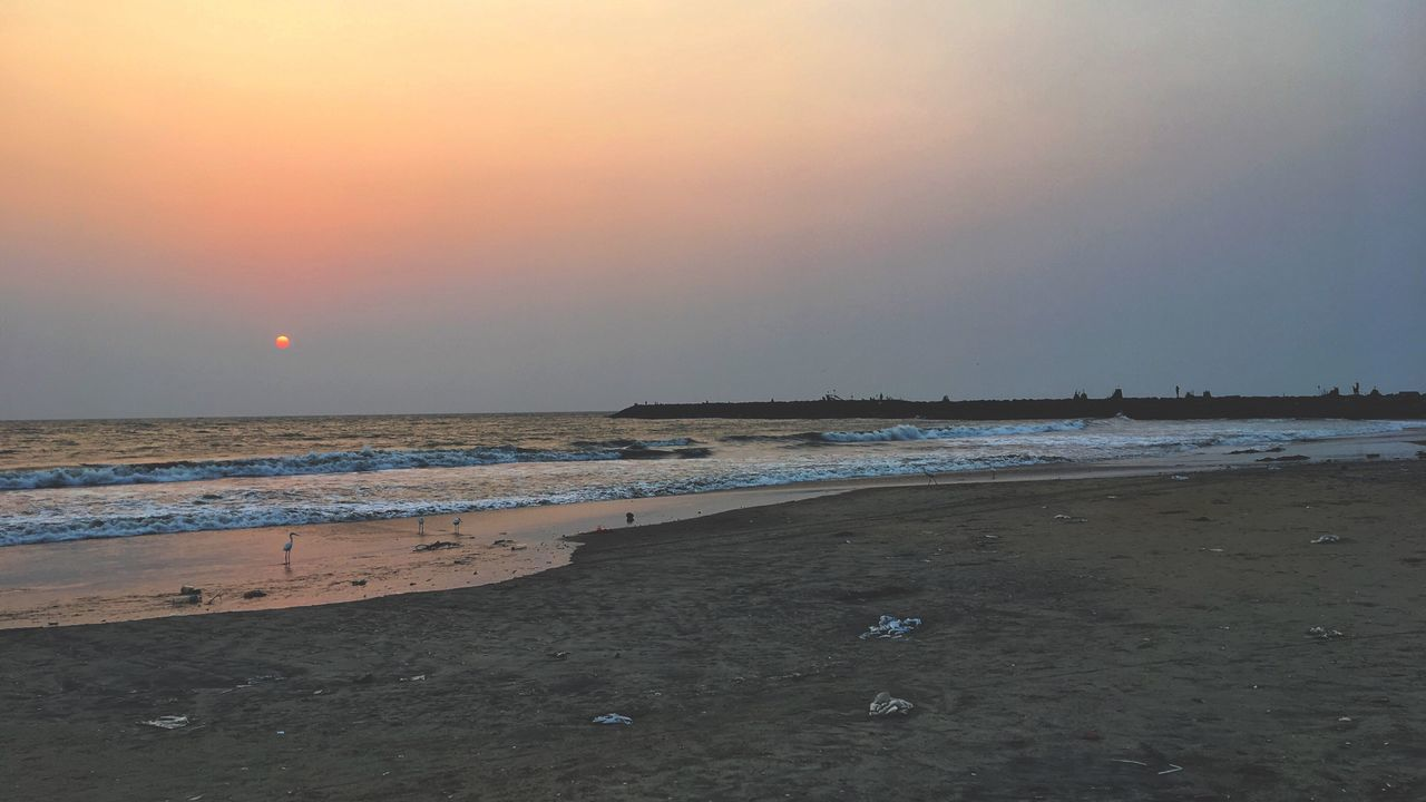 sea, beach, nature, sand, sunset, water, beauty in nature, shore, scenics, tranquility, tranquil scene, sky, horizon over water, outdoors, no people, sun, wave, day