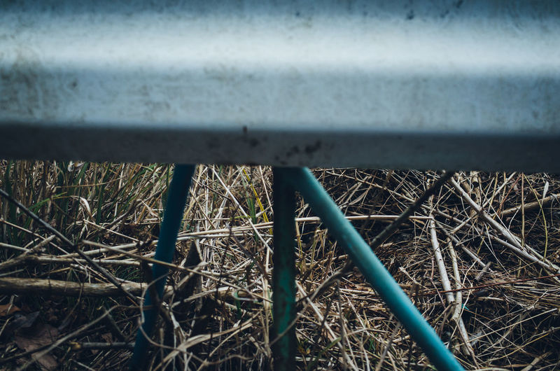 Still Life Abstract Color Redefining Outdoors Simplicity Simple Minimalism Minimal Metal Day No People Plant Nature Close-up High Angle View Growth Selective Focus Grass Land Railing Protection Wall - Building Feature Field Architecture Rusty Safety Security Wheel