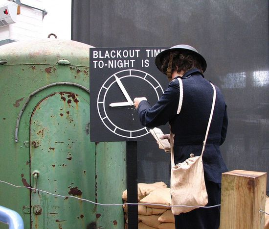 Air raid warden lady Adult Adults Only Air Warden Architecture Blackout Built Structure Casual Clothing Communication Day Leisure Activity Lifestyles Men One Person Outdoors People Real People Rear View Standing Text Women The World Before Bin Laden