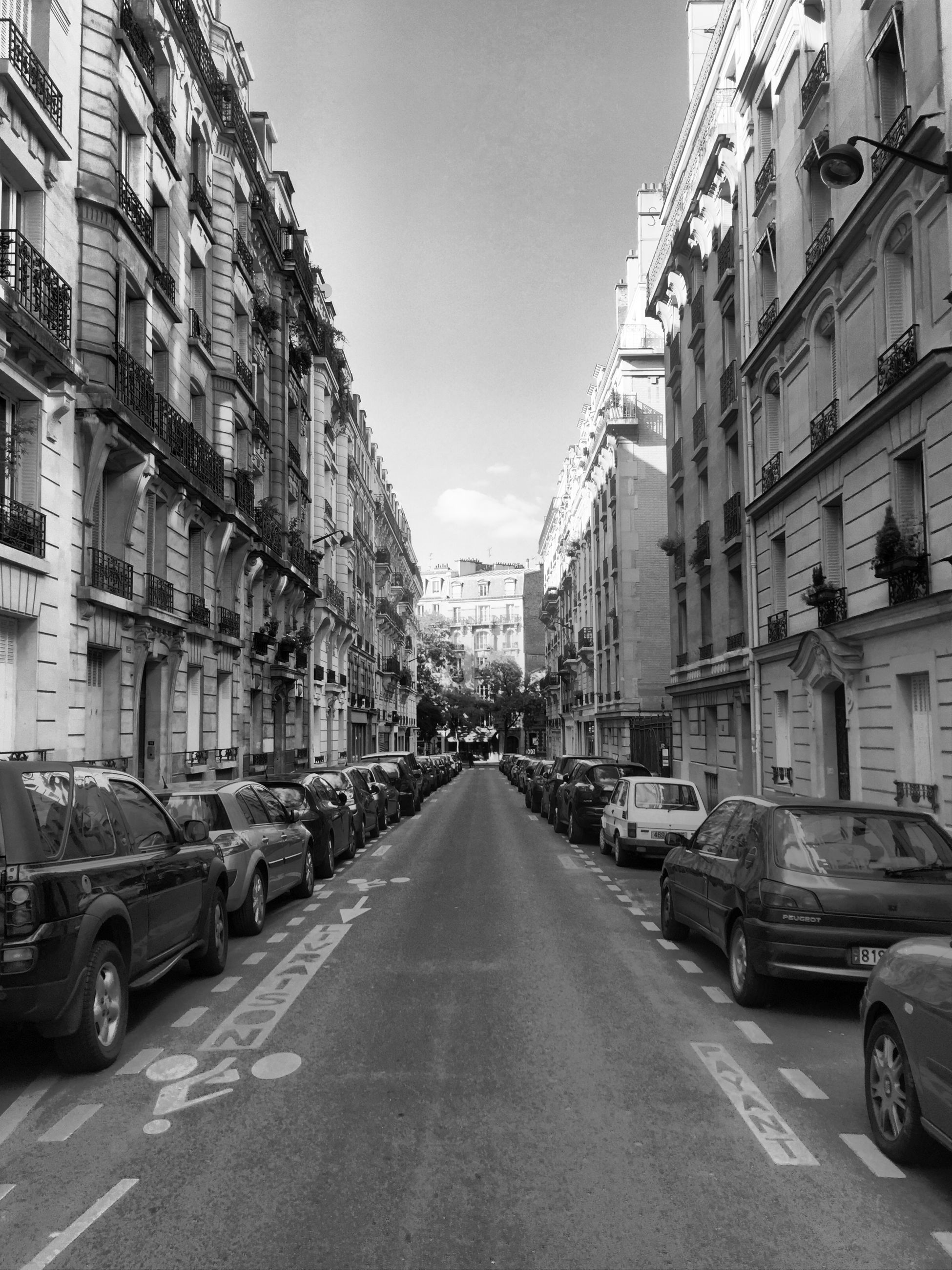 architecture, built structure, building exterior, city, the way forward, street, high angle view, residential building, diminishing perspective, incidental people, city life, vanishing point, transportation, residential structure, building, residential district, city street, car, sky, road