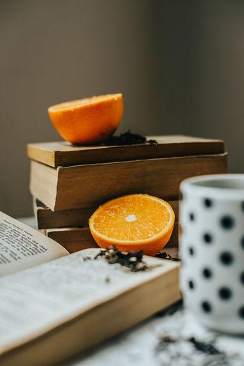 Close-up of orange on cutting board