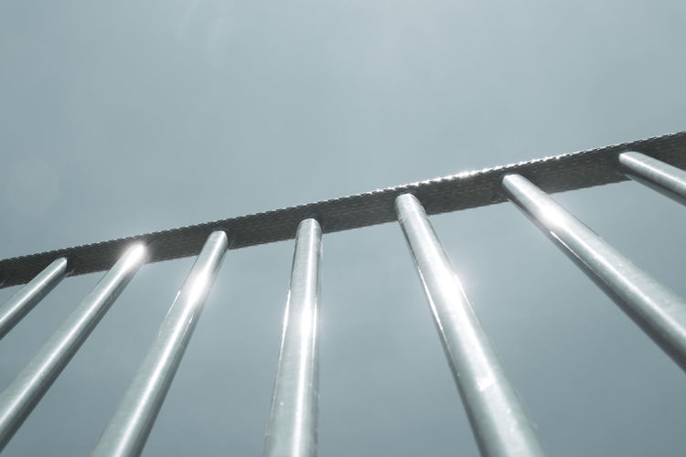 Low angle view of metallic structure against clear sky