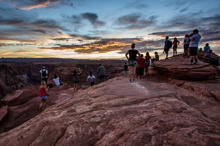 People At Horseshoe Bend In Grand Canyon National Park Against Sky