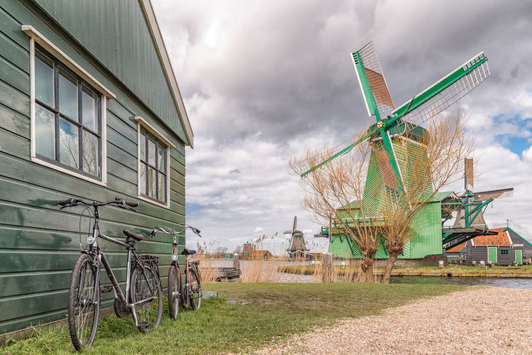 Bicycle and windmill in Zaanse Schans, Netherlands Alternative Energy Architecture Bicycle Bike Building Exterior Built Structure Cloud - Sky Day Dutch Dutch Culture Dutch Landscape Field Grass Holland Mode Of Transport Nature Netherlands No People Outdoors Rural Scene Sky Traditional Windmill Typical Dutch Windmill Wooden